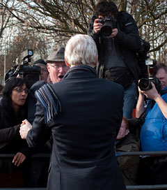 WikiLeaks Founder Julian Assange talks to demonstrators while leaving a court appearance for a verdict on an extradition request in London, February 24, 2011. (Photo: Andrew Testa / The New York Times)