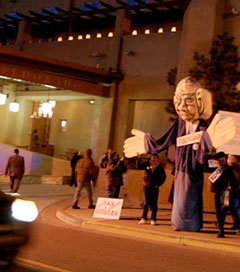 Protesters, supported by Occupy Santa Fe, demonstrate against ALEC and the influence of money in politics outside the Eldorado Valley Hotel, January 25, 2012. (Photo: suenosdeuomi)